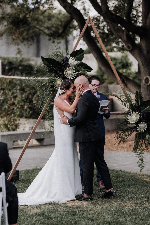 Oakland Museum of California Wedding #fallwedding #modernwedding #minimalswedding #BayAreaWeddingPhotographer #weddingprep #weddingday #weddingceremony #weddingdaydetails #firstkiss