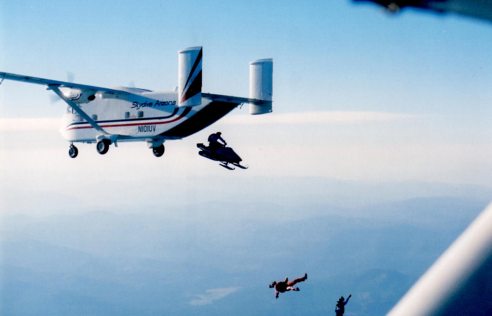 "In Greg's first snowmobile movie ""Mountain Mod Mania"" they jumped a snowmobile out of an airplane at 13,000 feet!"