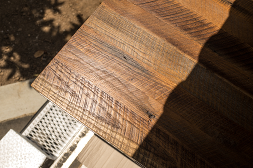 A corner of oak tabletop peeks out from the truck before being unloaded.