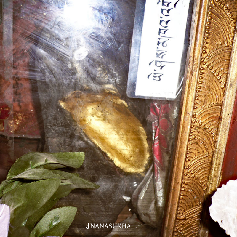 Khandro Yeshe Tsogyal gilded stone footprint at age 8. Preserved at Tsogyal Latso, Tibet. Photo 2009.