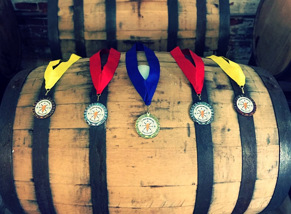 the five medals the Tap Brewing Company was awarded at the 2016 Great International Beer Festival.