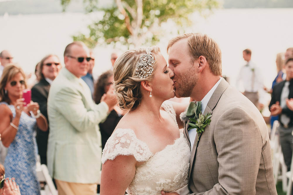ceremony kiss at lakeside wedding