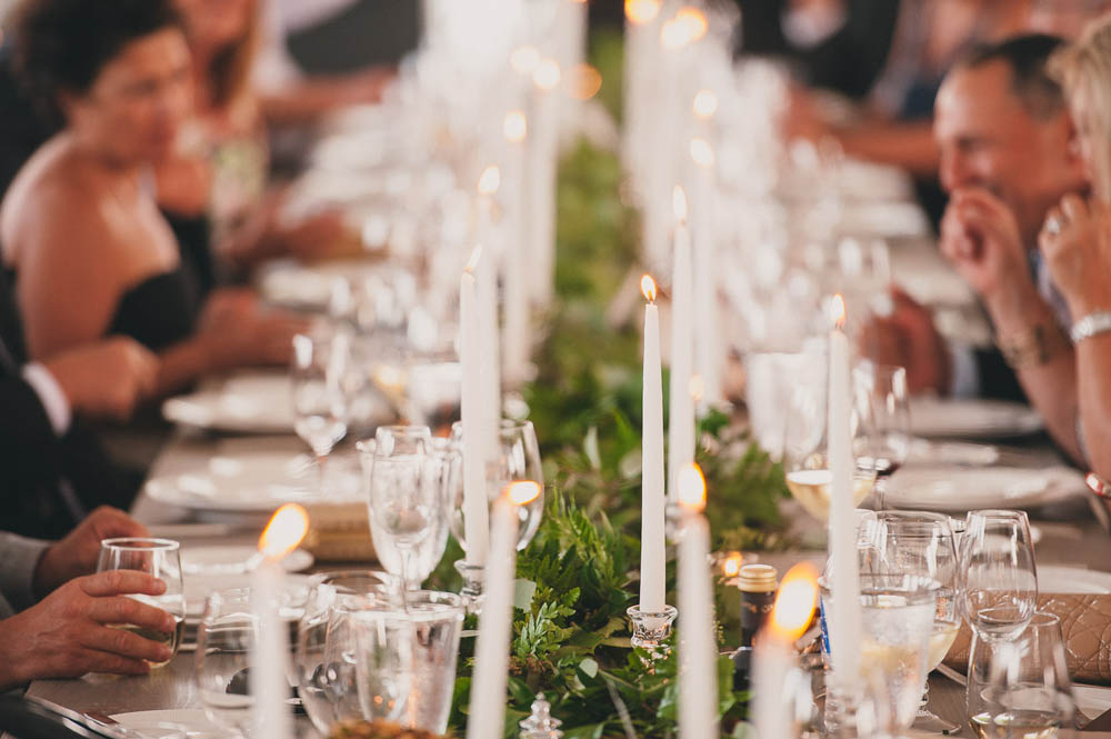 candlelit table and greenery wedding runner