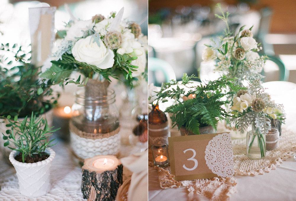 white centerpieces with ferns and greenery