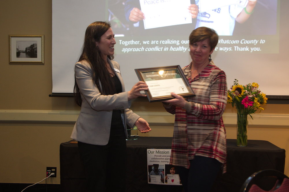 Joan Cervisi accepting her award. Photo by  Bellingham Photographer  Phil Rose.