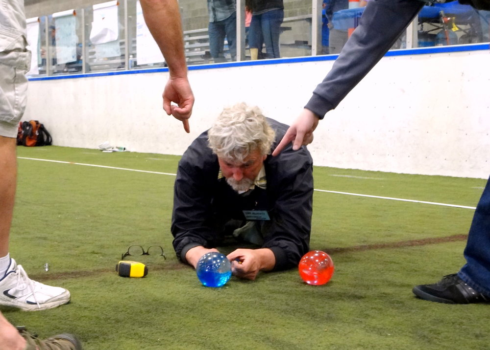 Tom McNutt, of Boccemon, refereeing a close match. Photo credit: Whatcom Dispute Resolution Center