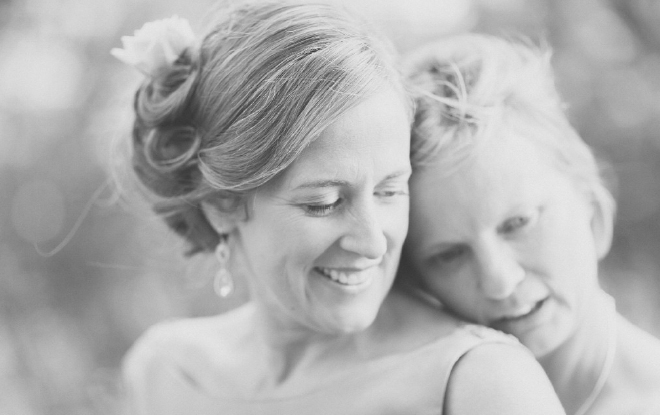Natural black and white portrait of bride and bride sharing a loving moment together.