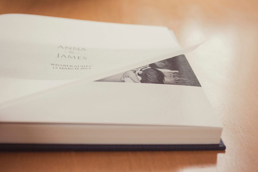 Detail photo of translucent title page in fine art wedding album.