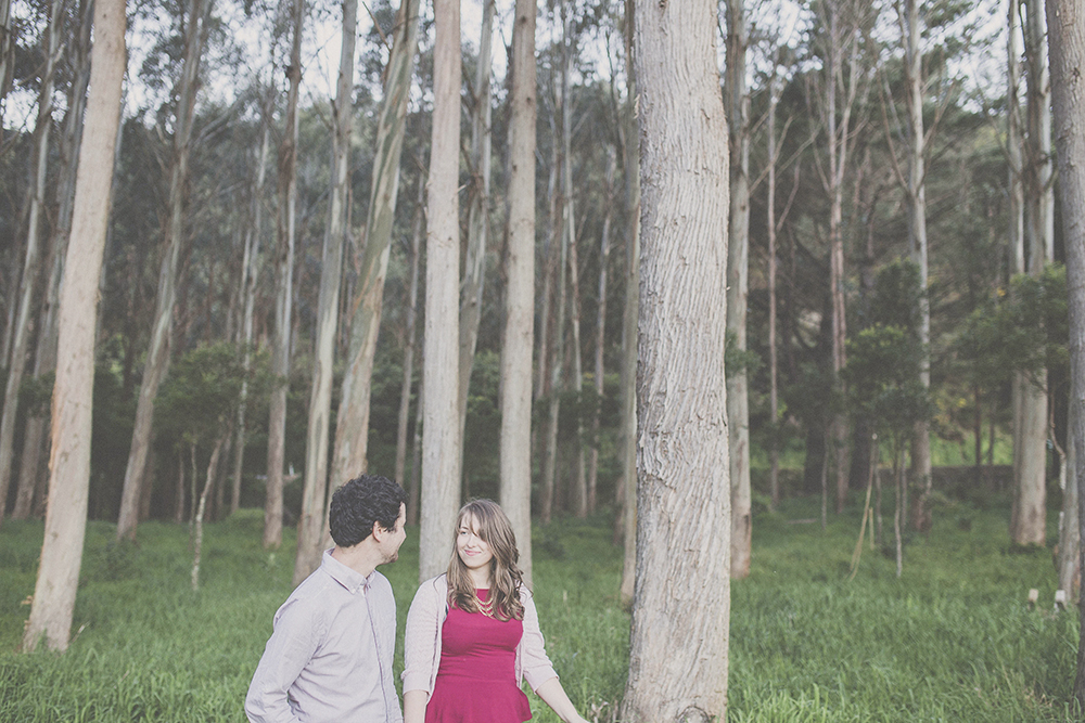 Couple walking together happily in eucalyptus forest.