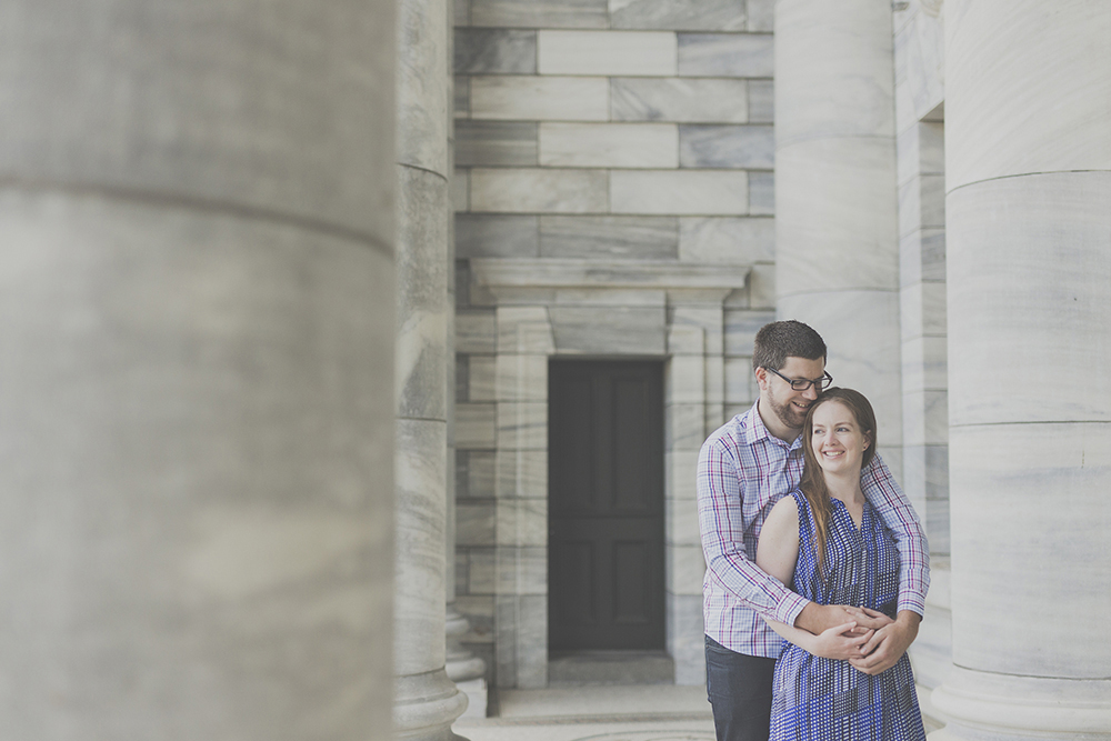 Cuddles at an engagement photo shoot in front of parliament in Wellington, NZ. Photo by Jenny Siaosi.