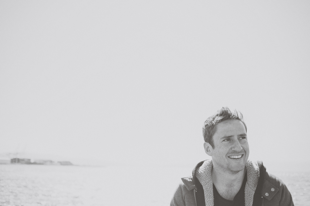 Black and white portrait of Happily engaged, Groom to be... waterfront in Wellington city.