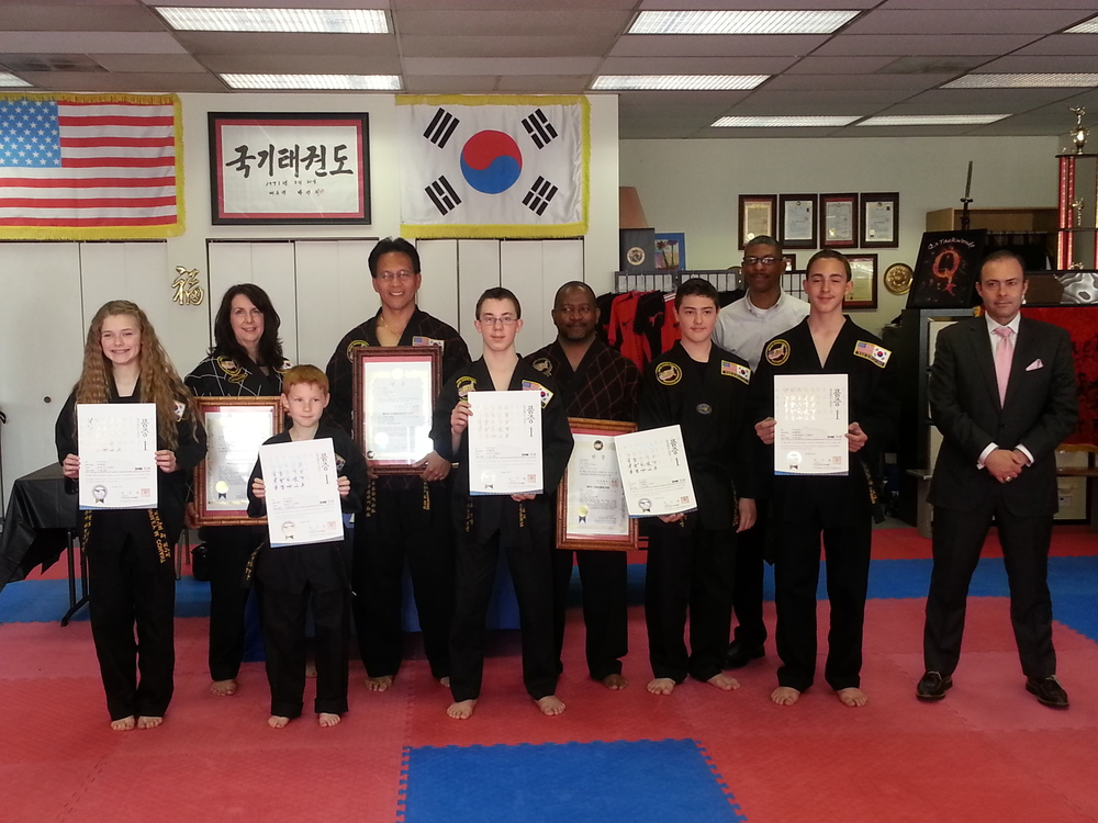All of our new and promoted Black Belts display their certificates.