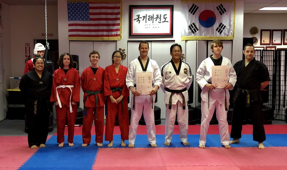 Two of our students receiving their 1st Dan (Black Belt) Certification with the World Taekwondo Federation