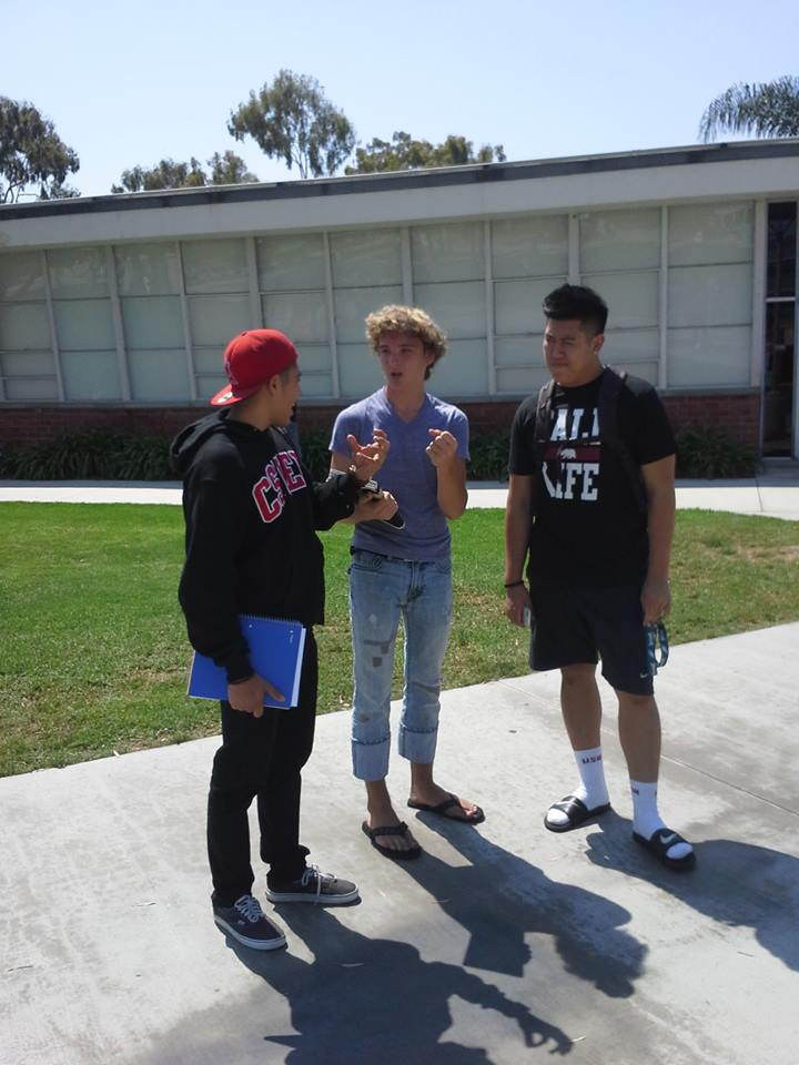 Ricky, center, on outreach at Orange Coast College, Costa Mesa, CA, right before going to a local high school
