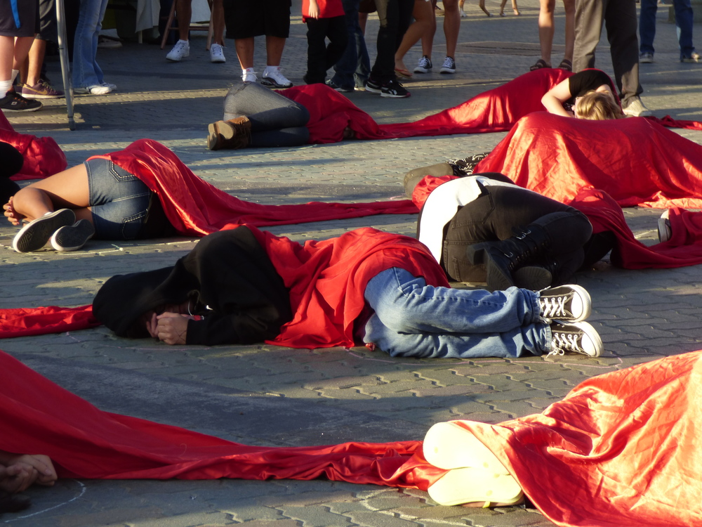 Million-to-one memorial die-in at Huntington Beach