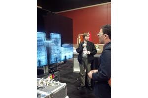 Sean Higgins looking at UCSD's big 3D Display.