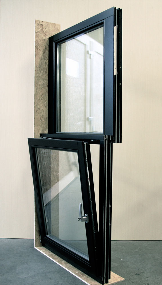 The fixed sash is connected to the operable sash to imitate the offset of a regular double hung window. This design was accepted by the Landmarks and Preservation Commission of New York City.