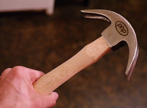 An actual double-clawed PHP hammer.  http://www.flickr.com/photos/raindrift/sets/72157629492908038/
