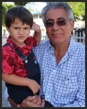 Derek with his son Tinirau after the 99th ANZAC Day ceremonies in 2014.