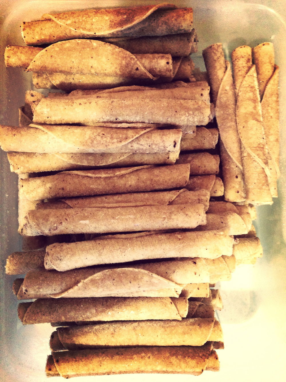Rolled tacos being rolled.jpg
