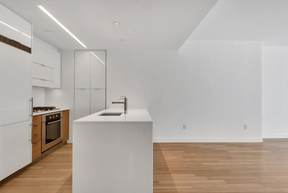 All kitchen counters are made with crystal white polished glass and custom bamboo cabinetry. State of the art appliances include a Bosch dishwasher, oven and cook top, and a Liebherr Refridgerator.