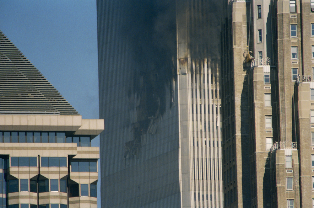 Day 1, North tower keeps burning, photo by Ski Shields