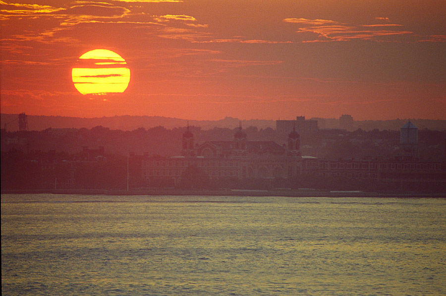 Day 7, Eerie sun over Ellis Island, photo by Ski Shields