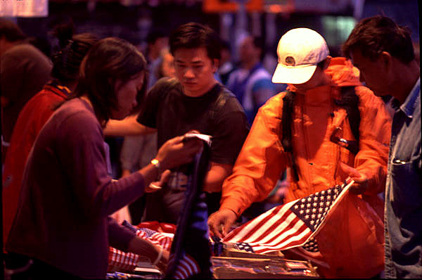 Buying American flags in Chinatown, photo by Michael Couzens, Sept. 13