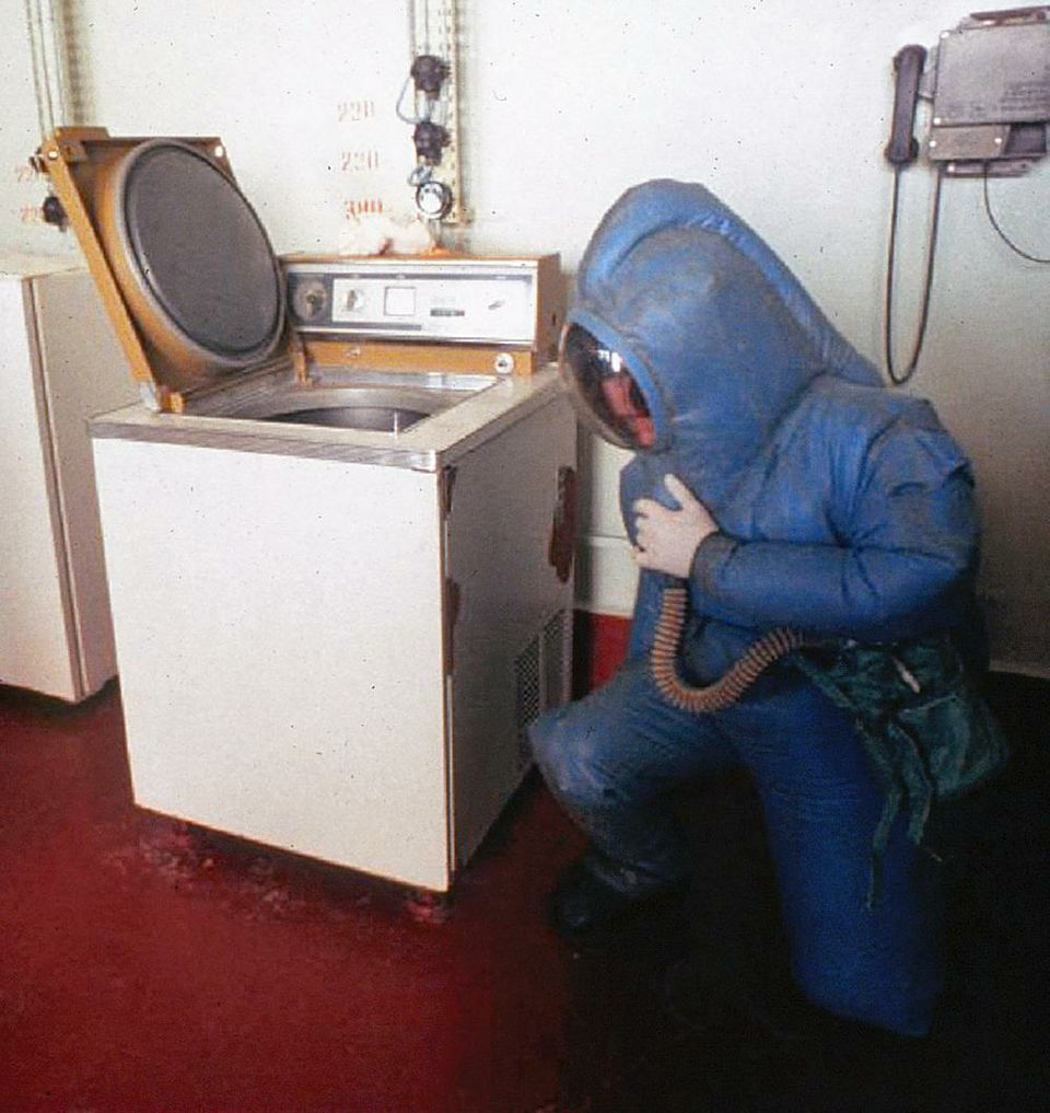 A Russian scientist works inside a maximum containment suit in the VECTOR biological warfare laboratory, located outside Novosibirsk, Russia.