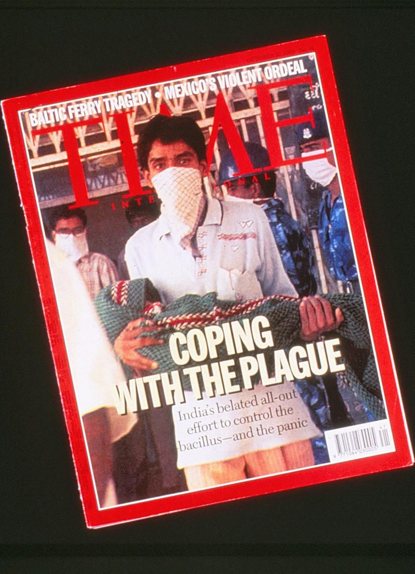 "TIME magazine's international edition calls for ""coping"" with the plague."