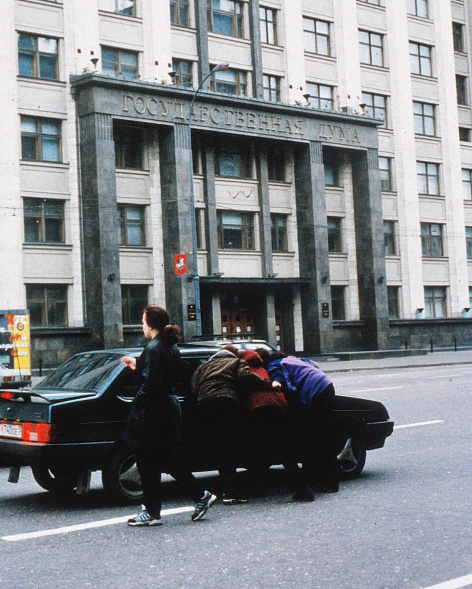 Female pimps hustle drivers in front of the Duma in Moscow.