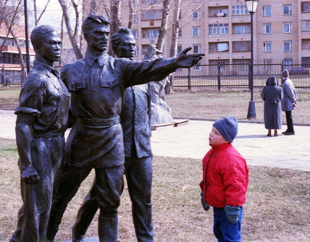 """Onward!"" the statue commands the child."