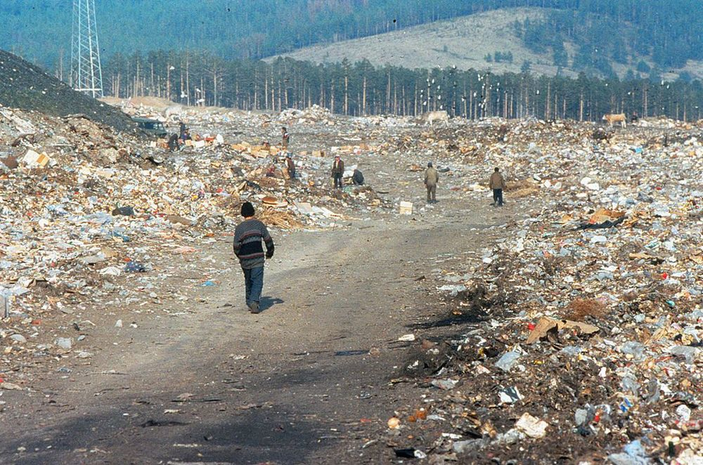 Outside Ulan Ude, Siberia children scrounge through garbage dumps in search of food.