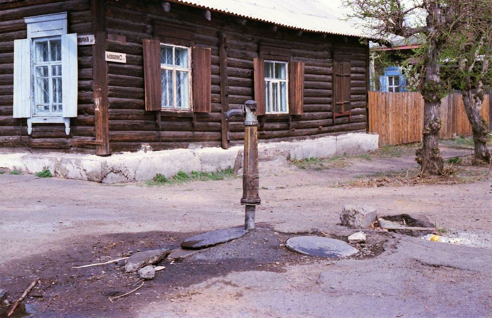 Despite industrialization, many Russians lack indoor plumbing, and the government says that half of all drinking water is unsafe. This pump serves a neighborhood of downtown Novosibirsk, Siberia.