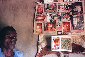 Bishanga Ndamwesiga, age 40, is dying of AIDS in his tiny home in Ntoma village, Tanzania. His 3-year-old daughter and wife are also dying of the disease. On his wall are all the memories they share.