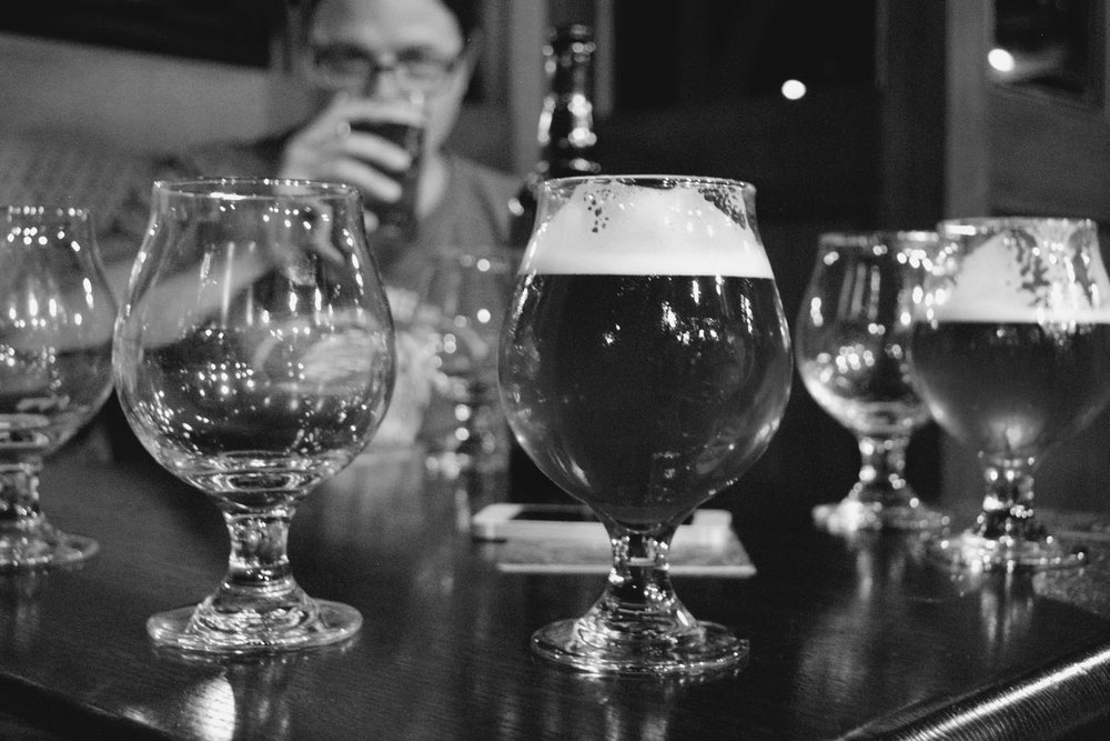 Founders' Brewmaster Jeremy Kosmicki eyes his creations at Timothy O'Toole's. [Photo: Jack Muldowney]