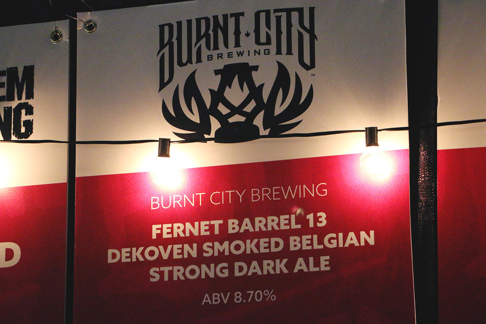 Burnt City x The Hop Review's collaboration, 13 DeKoven–a Belgian Strong inspired by the Great Fire.