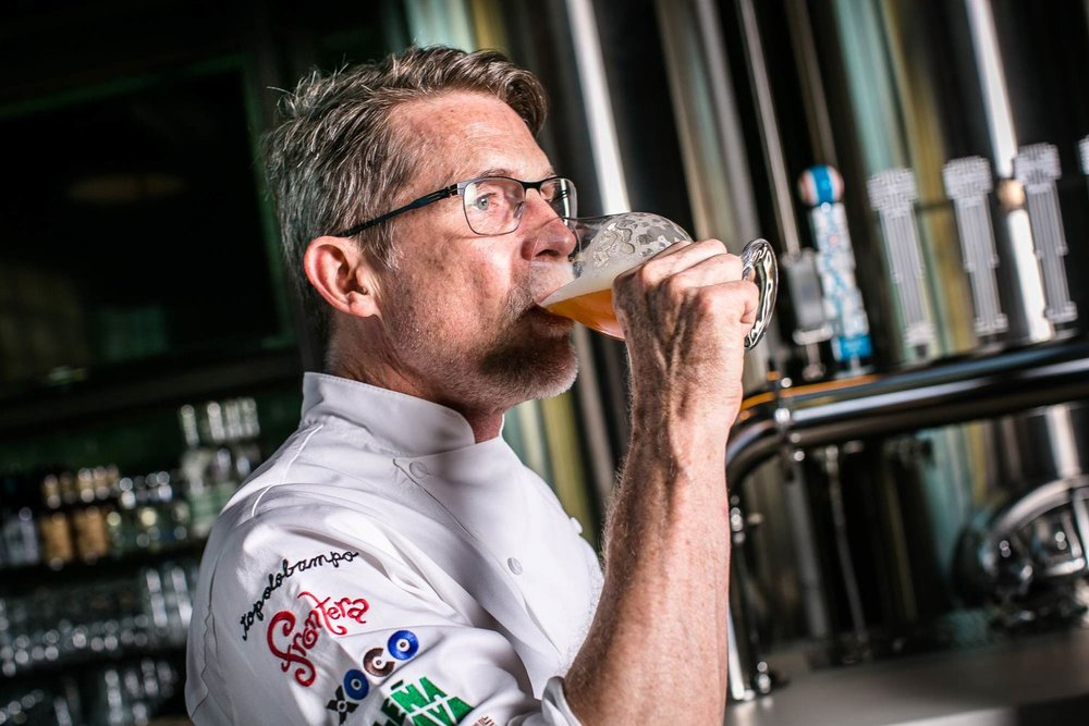 Mexican cuisine guru, Rick Bayless, enjoying an offering from his brewery, Cruz Blanca. [Photo:  Hilary Higgins ]