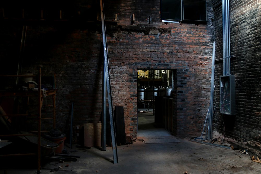 A doorway looking into the future EMBC taproom.