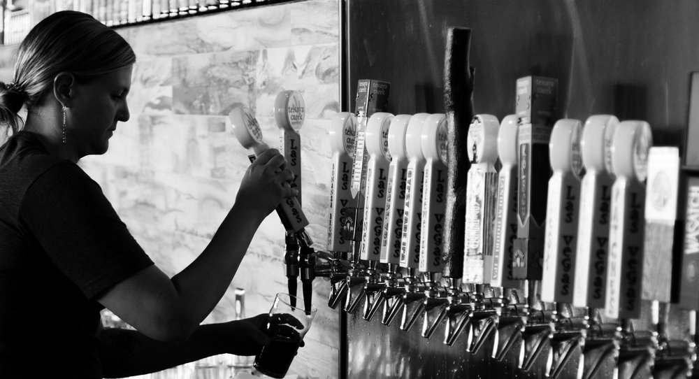 Ruth Orapka pours a pint at the Bonanza Road brewery & taproom