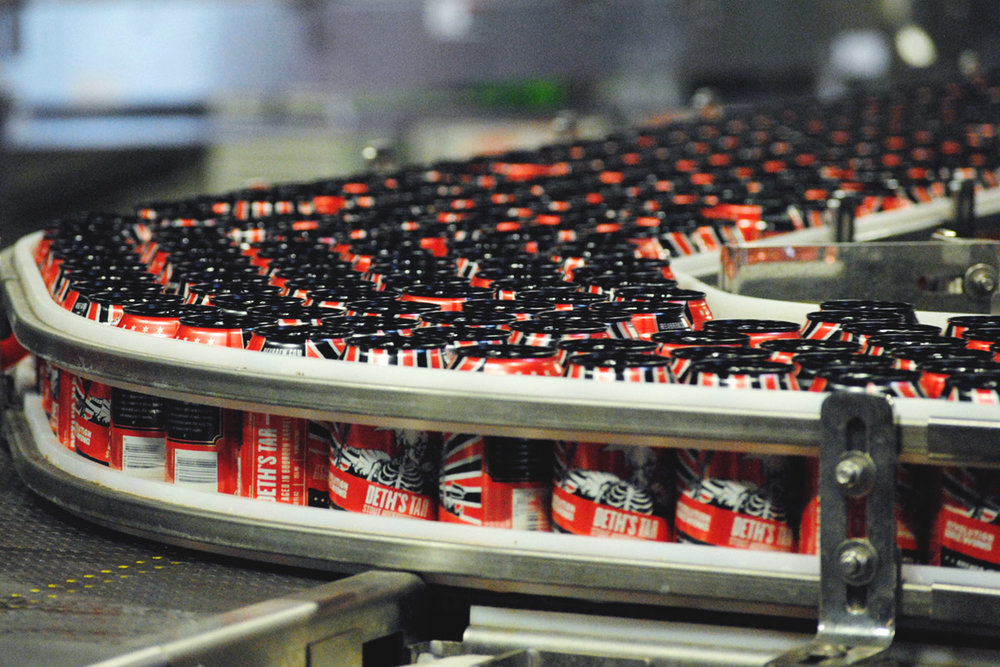 Thousands of  Deth's Tar cans make their way down the new canning line at Revolution's Kedzie brewery.