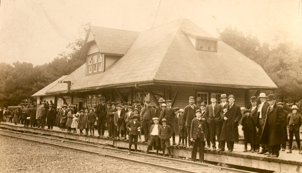A crowd of people stand outside the station on Nov. 2, 1900, waiting for the arrival of the very first train to Bancroft. Photo courtesy of the Bancroft Heritage Museum.