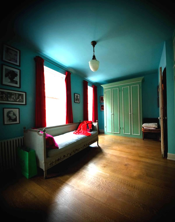 interiors by olatz aqua and red room.jpg