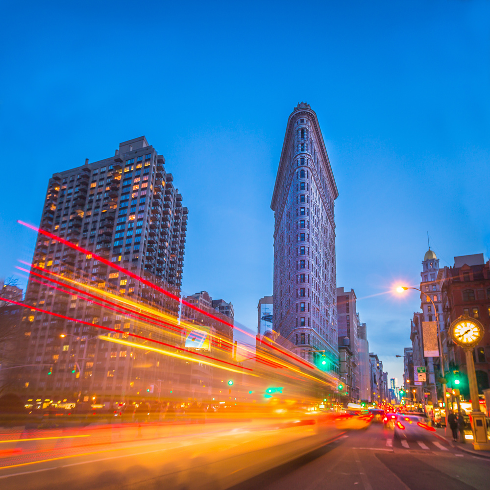streaks of traffic lights at dusk at the Flatiron Building, NYC