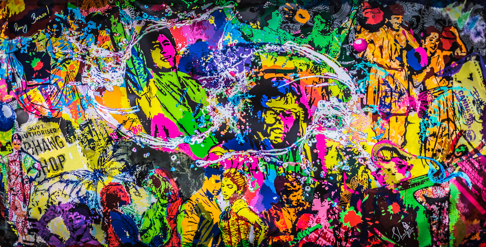 A crazily colorful Bollywood Holi painted on a wall
