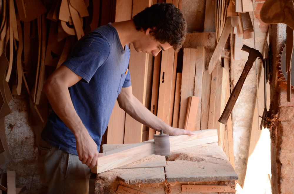 Gonzalo sanding some wood