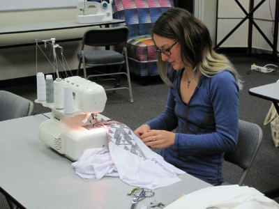 Redress Member (and Spoonflower team member) River Capel makes a shirt at a class in the Spoonflower Green House.
