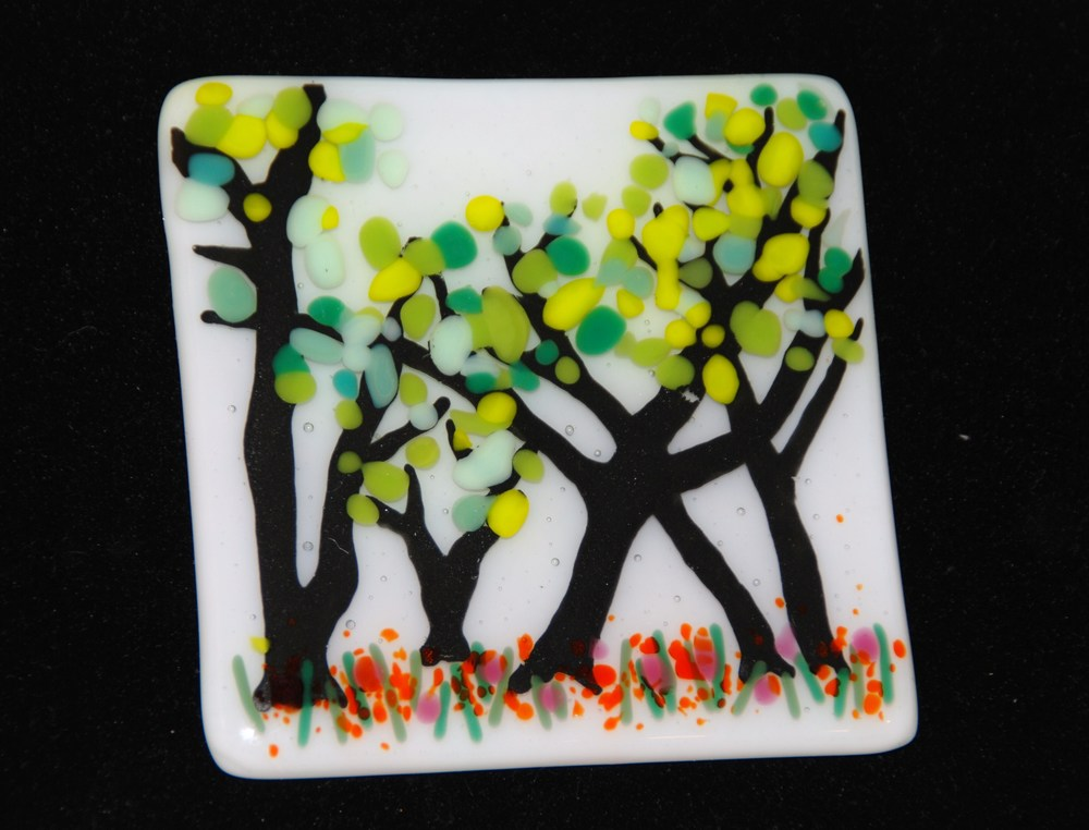 These fused glass tree tiles can be fully customized by changing the background color as well as the colors of the leaves and flowers below. Here are two examples.