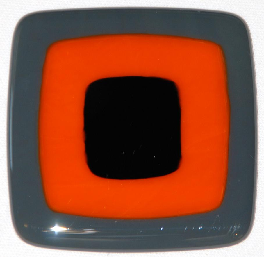 Craftsman fused glass tiles in slate gray, tangerine, and black