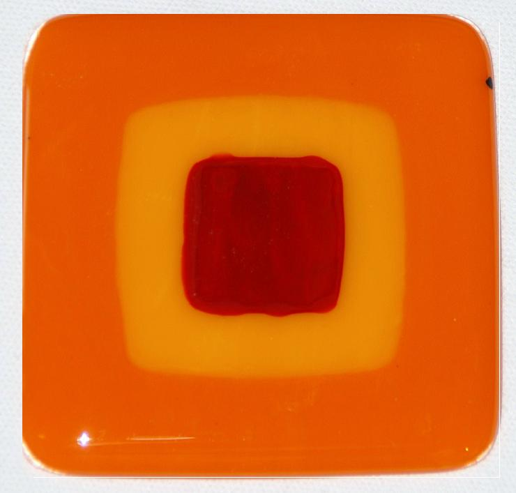 Craftsman fused glass tiles in tangerine, sunflower, and dark red